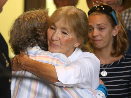 Diana Batzel Powers, sister of Raymond Batzel, who was killed in the 2003 robbery of the Xerox Federal Credit Union in Webster, hugs her mother Rowena Bennett after an announcement that there was an arrest in the case.