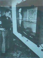 Real Eight guard James Lowe looks at a shattered museum treasure case in September 1976.