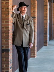 Roi Barnard poses for a portrait at Pizza by Elizabeths in Greenville on Sunday afternoon.