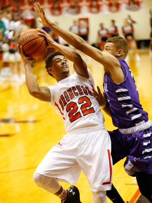 Lafayette Jeff's Dan Ricksy tries to muscle up a shot over Jamel Barnes of Muncie Central Friday, January 8, 2016, at Lafayette Jeff. Jeff couldn't keep up with Muncie Central, falling 74-60.