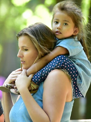 Anela Hadzalic, Gettysburg, gives her 3-year-old daughter, Kylie Martinez a ride on her shoulders as they visit Caledonia State Park on Tuesday, September 6, 2016. Temperatures will reach into the 90s for much of this week.