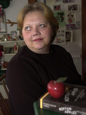 "Patricia Powell, shown in this 2003 Town Talk photo, was the victim of political retaliation, a teacher with glowing reviews who was transferred to ""the worst possible teacher position in Rapides Parish"" and subjected to harassment weeks after her comments about a controversial settlement were published in The Town Talk."
