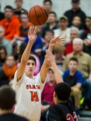 Palmyra's Isaac Blatt fires a jump shot over Dover's Elijah Sutton as Palmyra defeated Dover 61-53 in the first round of the District 3 Class 5A basketball tournament on Monday, Feb. 20, 2017.