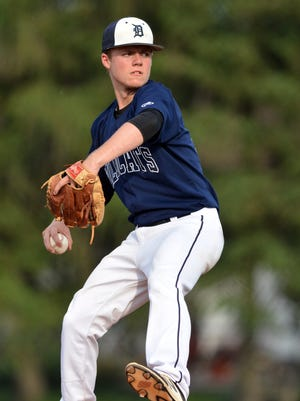 Dallastown's Alex Weakland delivers a shut-out against Gettysburg during the York-Adams baseball championship at Spring Grove High School, Wednesday, May 17, 2017.  Weakland, a sophomore, is part of a deep pitching staff at Dallastown that's helped the team win 17 consecutive games. John A. Pavoncello photo