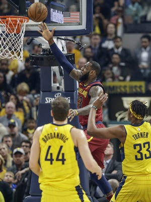 Cleveland Cavaliers forward LeBron James (23) gets an easy layup after spinning by Indiana Pacers center Myles Turner (33) during the first half of Game 4 at Bankers Life Fieldhouse on Sunday, April 22, 2018.