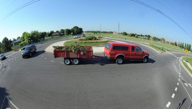 Roundabouts are now being built in Greenwood, Johnson County. Here at Fairview and Morgantown Roads motorist maneuver around and through the roundabout. Matt Kryger / The Star