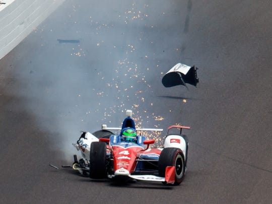 May 28, 2017; Indianapolis, IN, USA; IndyCar Series driver Conor Daly crashes in turn three during the 101st Running of the Indianapolis 500 at Indianapolis Motor Speedway. Mandatory Credit: Guy Rhodes-USA TODAY Sports