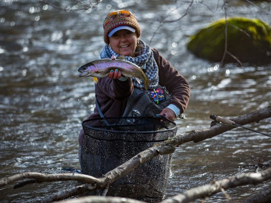 Tammy Neal lands a rainbow trout at the last Casting for Hope Fly-Fishing Competition in Bakersville. The event, coming up April 13-15, is a fundraiser for fly-fishing retreats, free to women in WNC with ovarian or gynecological cancers.