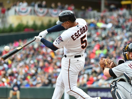 Minnesota Twins hitter Eduardo Escobar makes contact for a single against the Detroit Tigers in the fourth inning of a baseball game, Sunday Oct. 1, 2017, in Minneapolis. Minnesota won 5-1. (AP Photo/John Autey)