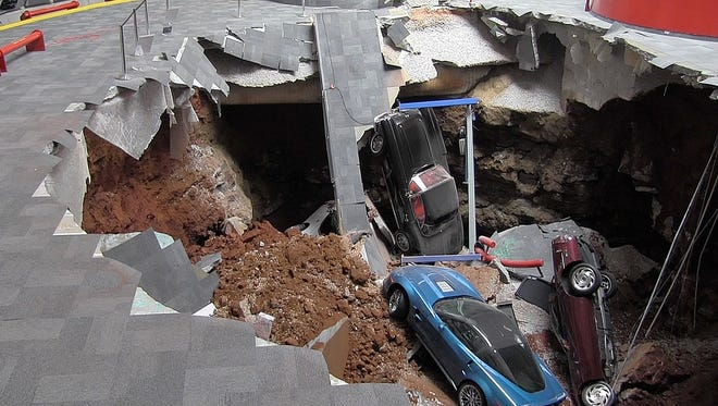 A 40-foot sinkhole at the National Corvette Museum in Bowling Green, Ky., swallowed eight of the sports cars on display inside the the facility's iconic Sky Dome early Feb. 12, 2014.