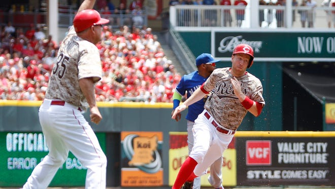 Reds third baseman Todd Frazier rounds third base on his way to score during the first inning Sunday.