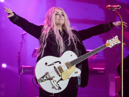 Kesha performs live on stage during Redfestdxb Festival