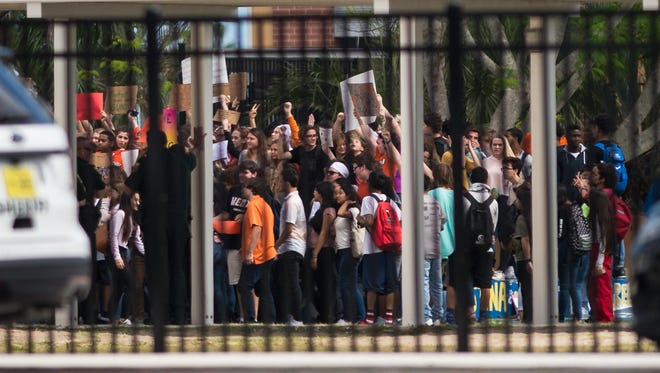 A walkout planned for 12 p.m. takes place Wednesday, Feb. 21, 2018, at Martin County High School in Stuart. The protests were planned nationally in the wake of the Marjory Stoneman Douglas High School school shooting last week.