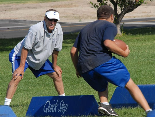 Bob Bateman, left, directs drills during a Carson football