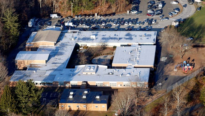 This aerial file photo shows Sandy Hook Elementary School in Newtown, Conn.