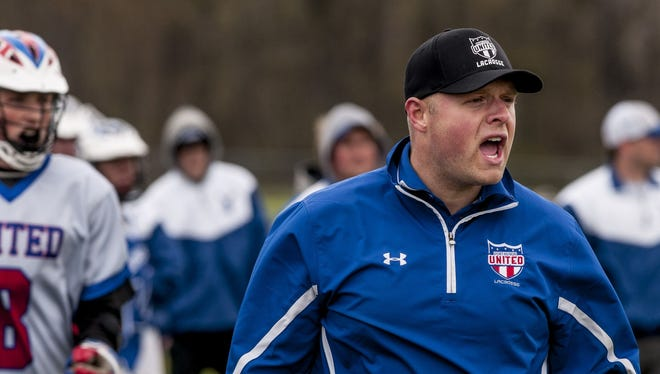 Port Huron United coach Jon Holden yells from the sidelines during a lacrosse game Saturday, May 14, 2016 at Port Huron Northern High School.
