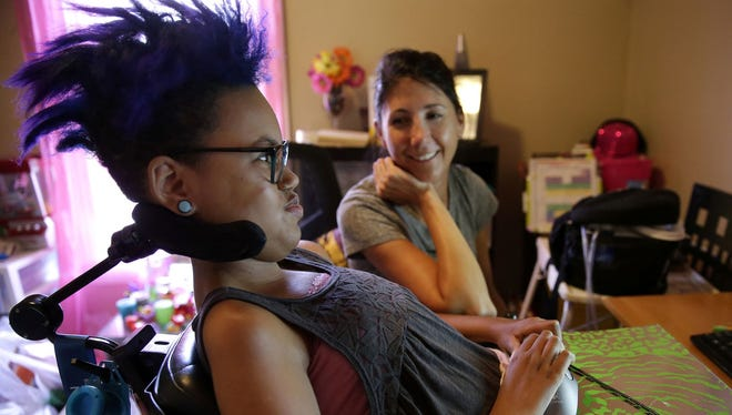 Jerika Bolen, 14, browses the internet to show Angie Frank, a private duty nurse that has been working with the Bolen family for over a year, one of the accessories she purchased for her prom Tuesday, June 21, 2016 in Appleton, Wis. One of Jerika's wishes when she went on hospice was to have a prom which will be on July 22 at the Grand Meridian in Appleton, Wis.