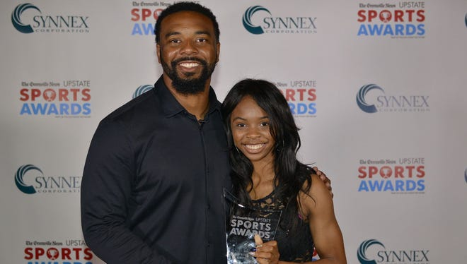 Kennedy Dennis, with former Clemson star Tajh Boyd after receiving The Greenville News All-Upstate Track Athlete of the Year award, has been named Track Athlete of the Year in Class AAA by the South Carolina Coaches Association for Women's Sports.