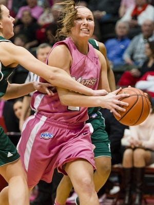 Marist College's Eileen Van Horn moves to shoot as Manhattan College's Maggie Blair attempts to defend during their game at the McCann Arena in Poughkeepsie on Sunday, February 17, 2013.