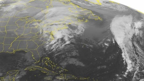 This NOAA satellite image taken Monday, Dec. 8, 2014 at 12:45 PM EST shows a winter storm moving eastward into the Great Lakes region with mixed rain and snow fall across the area. This precipitation is affecting most of western Michigan and the western Ohio River Valley. Another complex low pressure system located just to the east of the Carolinas will progress northward towards New England causing Nor\'Easter conditions within the next couple days.