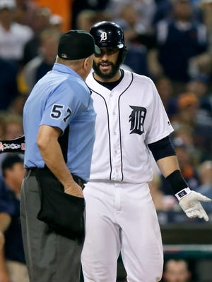Tigers rightfielder J.D. Martinez talks with home plate umpire Mike Everitt after being ejected during the sixth inning of the Tigers' 3-2 loss to the Angels Saturday at Comerica Park.