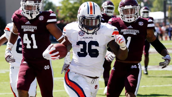Auburn running back Kamryn Pettway (36) runs past Mississippi