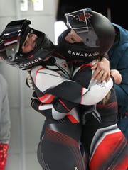 Heather Moyse and Alysia Rissling of Canada celebrate