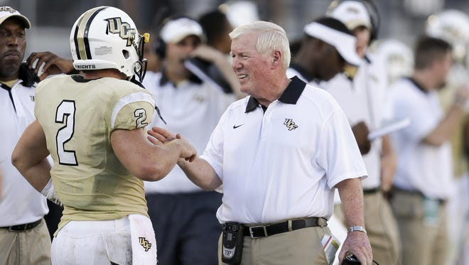 UCF coach George O'Leary, right, talks with wide receiver Nick Patti during a September game.