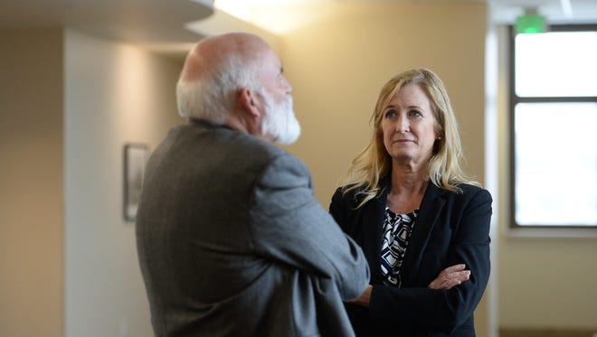 Poudre School District Superintendent Sandra Smyser talks with David Trask, PSD board of education vice president, at the Larimer County Justice Center on Thursday, February 23, 2017.