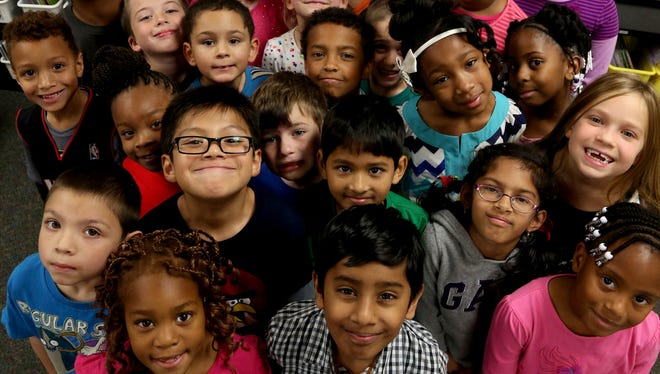 Barb Kilgore's second grade class is all smiles on Oct. 21, 2014, at R. Grant Graham Elementary School in Auburn Hills. The school is one of the most diverse in the state of Michigan and has double-digit percentage representation of blacks, whites, Hispanics and Asians.