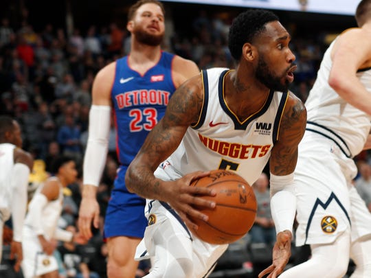 Denver Nuggets guard Will Barton, front, picks up a loose ball in front of Detroit Pistons forward Blake Griffin in the first half of an NBA basketball game Tuesday, March 26, 2019, in Denver. (AP Photo/David Zalubowski)