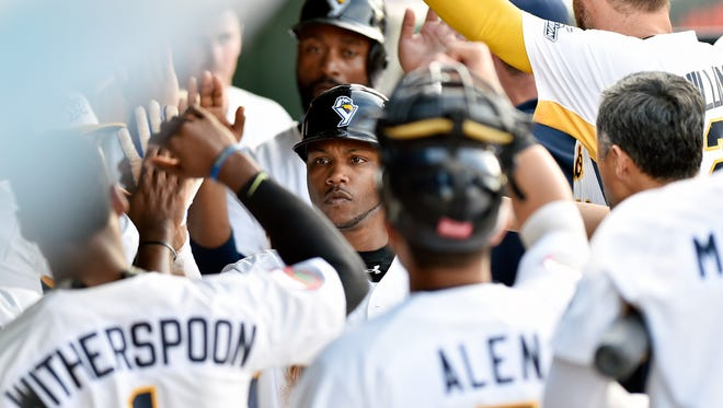 York Revolution infielder Alonzo Harris is greeted by teammates in the dugout after earning a run on Angel Franco's double-RBI single in the first inning of the York Revolution's first home game Friday, April 28, 2017, at PeoplesBank Park in York. The Revolution, now in their 11th year, opened their homestand with a three-game series against Somerset.
