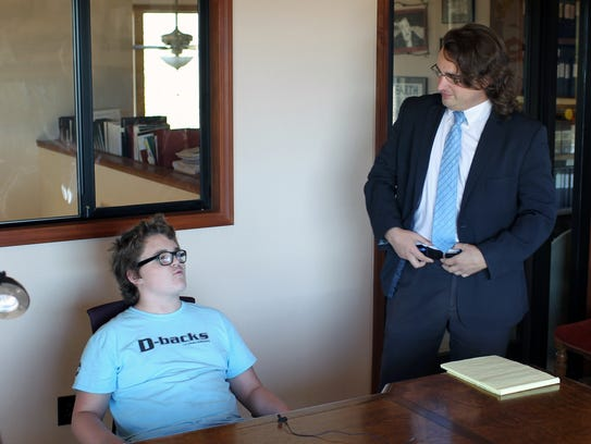 Joshua Brown, left, speaks Monday alongside Redding, Calif., attorney Ryan Birss. Joshua, 13, and his parents received a cease-and-desist letter from U.S. Rep. Doug LaMalfa's office in August over the family's alleged repeated contacts to the office.