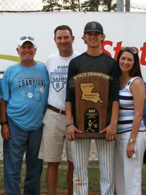 Gunner Leger holds Barbe's 2014 Class 5A state championship trophy along side his grandfather Wallace, left, father, Tim, and mother, Ashley. Leger went on to sign with UL and was the Cajuns' ace pitcher during his freshman and sophomore seasons.