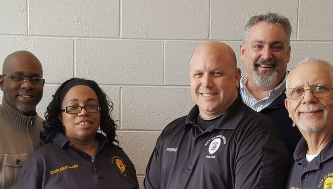 Burlington City policeman Robert Perro (third from the right), stands with members of the Burlington City Police Department police chaplains. Burlington City's team is joining with several other towns to form a shared Riverfront Police Chaplains Response Team.  The Burlington City Police Department police chaplains pictured with Perro are: Veronica Pollard (left),Joe Domosh and Ed Bowles