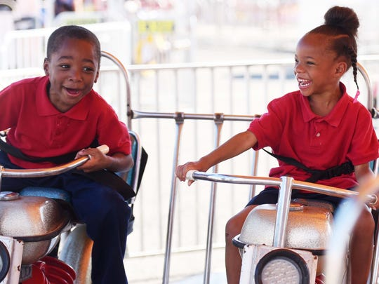 Central Garner and Jakaly Garner have big smiles as they go for a ride during the first day of the State Fair of Louisiana. The annual event attracts more than 400,000 people each year and hosts the largest carnival and livestock show in the state.