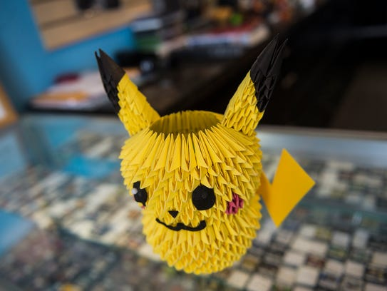 A Pikachu replica is kept near the front desk at Press
