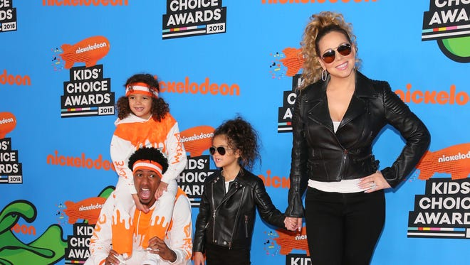Mariah Carey and Nick Cannon arrive with children Monroe Cannon (2R) and Moroccan Scott Cannon (top) at the Nickelodeon Kids' Choice Awards.