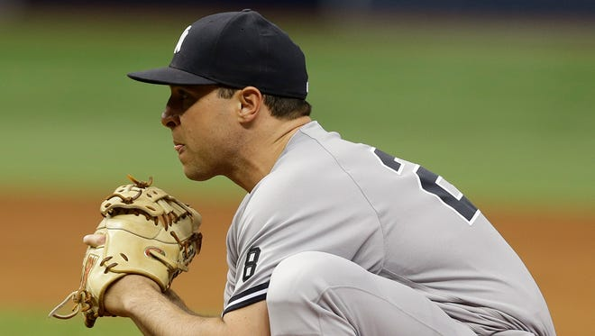 New York Yankees first baseman Mark Teixeira stretches during the seventh inning of a baseball game against the Tampa Bay Rays Sunday, May 29, 2016, in St. Petersburg, Fla.  (AP Photo/Chris O'Meara)