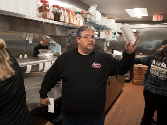 Amato Bros. owner Mike Amato works in the kitchen of