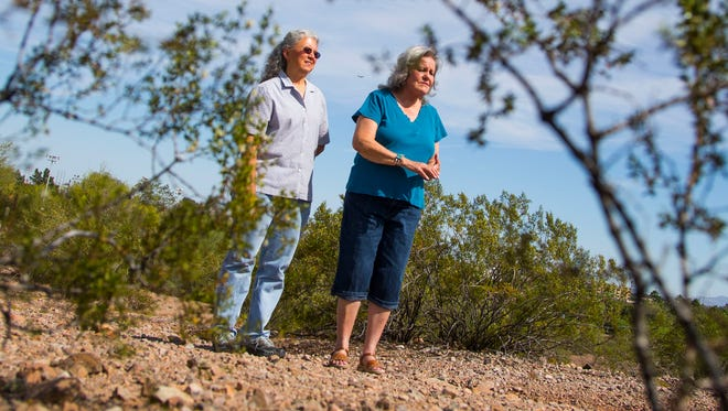 Darlene Justus (right) and Deb Gain-Braley talk about land they are urging the Tempe City Council to formally declare the part of Papago Park that's in Tempe a preserve area in Tempe, Ariz. on Thursday, April 14, 2016.