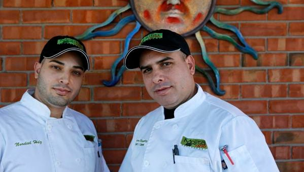Mojito chef Perdro Hernadez, right, and his brother Nordial, the sous chef at the restaurant.  Jan. 15, 2015.