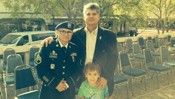 Alexandria Mayor Jacques Roy and his son, Jude-Michael, stand with Staff Sgt. Nathan Akridge of Fort Polk after a Veterans Day ceremony at the Veterans Memorial Plaza outside Alexandria City Hall. Akridge was one of the keynote speakers for the ceremony, and Mayor Roy welcomed those attending.
