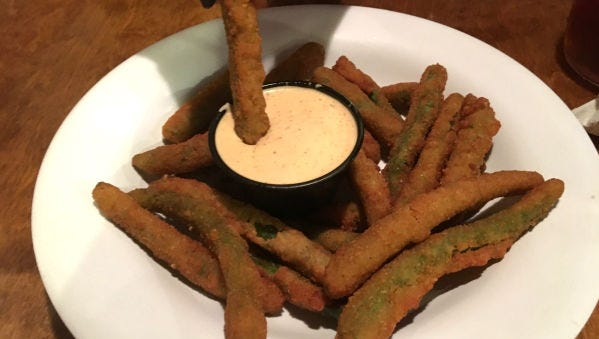 Cowboys' fried green beans were crunchy breaded green beans served with a zesty ranch sauce. The green beans were crisp and fried golden brown.