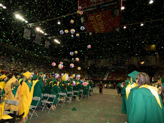 Confetti and large beach balls signal the start of