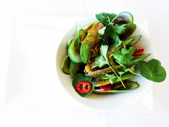 New Zealand green-lipped mussels served with red chili,