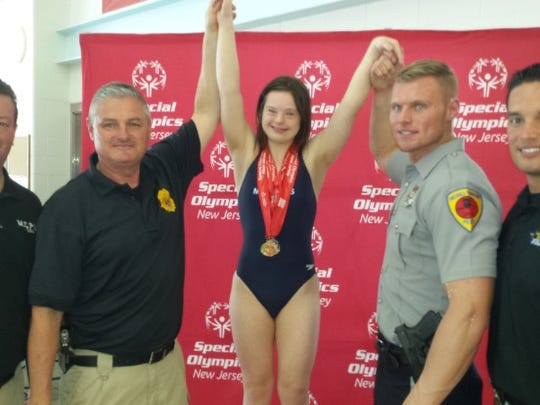 Alaina Ladaro after winning gold medals in swimming at the Special Olympics