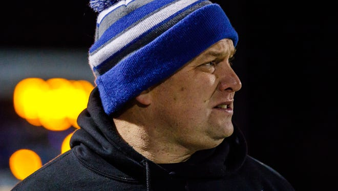 Brookfield Central head coach Jed Kennedy keeps an eye on the action during the Level 4 Division 2 playoff game against Waukesha West at Oconomowoc on Friday, Nov. 10, 2017.