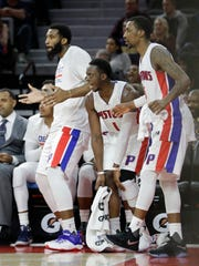 (From left) Pistons center Andre Drummond, and guards