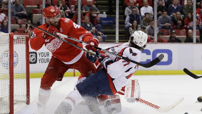 Red Wings left wing Henrik Zetterberg checks Capitals right wing T.J. Oshie during the first period Saturday, Feb. 18, 2017 in Detroit.